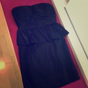 Strapless fitted black peplum dress